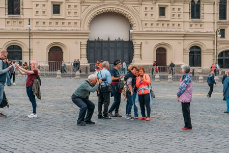Moscow, Russia - circa September 2018 : Tourists on Red Square - center of Moscow near Kremlin, popular tourist place.