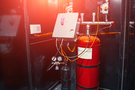 Modern industrial automatic fire extinguishing system, close up with red light effect Imagens