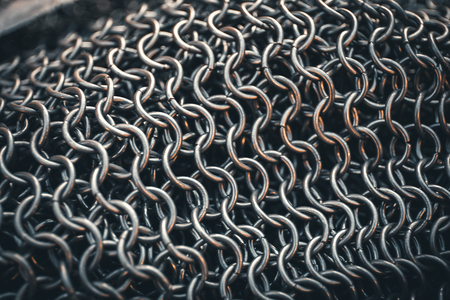 Chain-mail or Hauberk texture, metal protective armor of medieval or middle ages times, close up macro shot