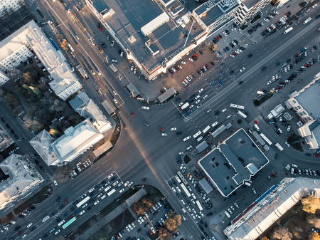 Road car traffic on crossroad or intersection downtown on asphalt road of European city, aerial or top view from drone, urban transportation concept, toned
