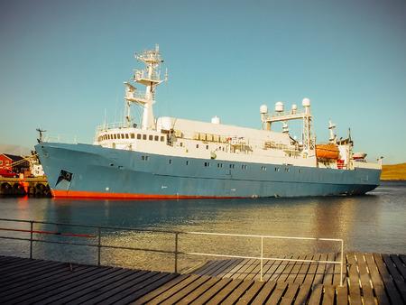 Industrial ship in port deck. Sea vessel in harbor.