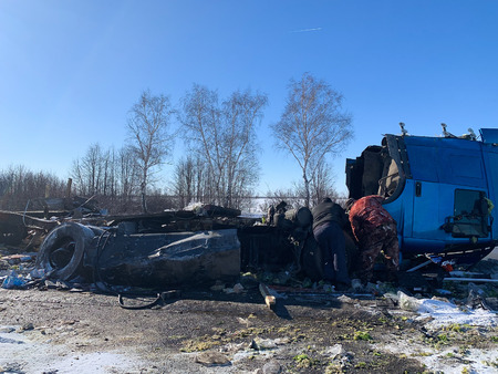 Crashed and damaged freight cargo truck after road accident.