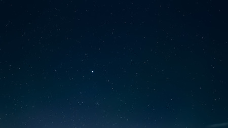 Night sky with stars background, colourful space or cosmos abstract wallpaper, toned Banco de Imagens