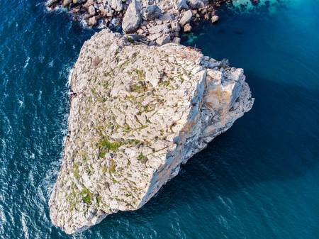 Aerial view of rock cliff Diva in Simeiz sea resort beach in Crimea, drone shot. Beautiful summer vacation nature landscape in mountain area, toned Фото со стока