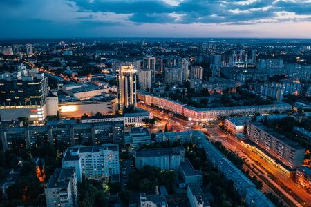 Aerial view of night European city Voronezh midtown or center panorama with modern buildings, drone shot from above, toned