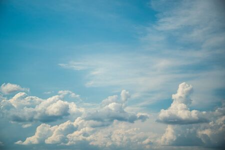 Blue sky with white clouds in windy sunny weather, heaven background.