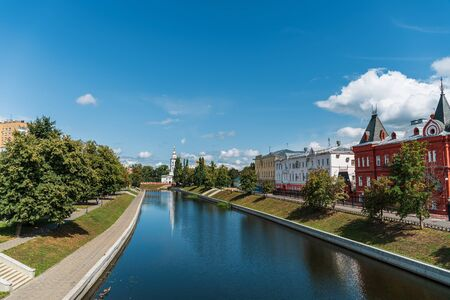 Oryol or Orel city embankment in summer day, Russia. Oka river and historic and religious buildings.