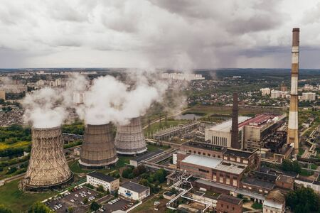 Smoke from chimneys of thermal power plant or station, aerial view from drone, toned Reklamní fotografie