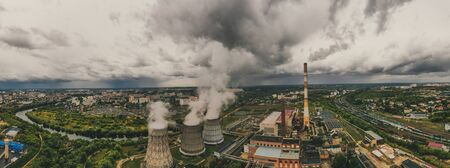 Aerial panorama of industrial area with chimneys of thermal power plant or station with smoke, railroad and other industry buildings, drone photo, toned