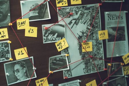 Detective board with photos of suspected criminals, crime scenes and evidence with red threads, selective focus, retro toned Banco de Imagens
