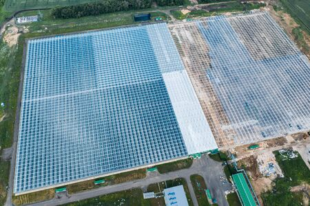 Aerial view of large modern greenhouse from above, drone photo. industrial agriculture concept.