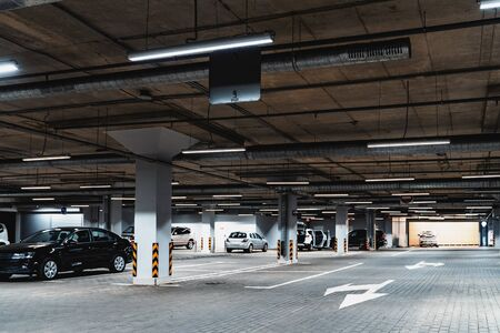 Underground garage parking lot, auto park interior inside, toned