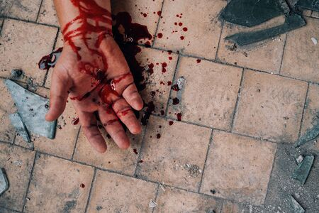 Crime Scene showing Human Hand in Blood on dirty floor