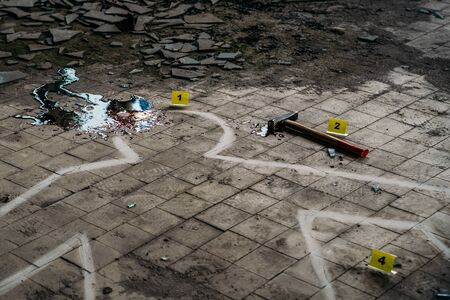 Crime Scene with Hammer on dirty floor Weapon of Killing and white chalk Outline of Murdered Body with Blood, close up