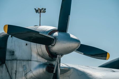 Propeller and engine of big old retro cargo airplane, close up.