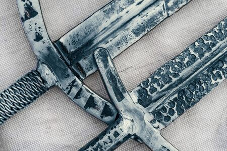Ancient swords blades, antique steel cold weapon of knights or fantasy warriors, close up top view.