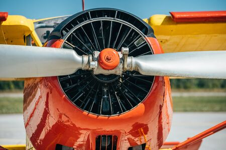 Engine and propeller of old retro airplane, close up.