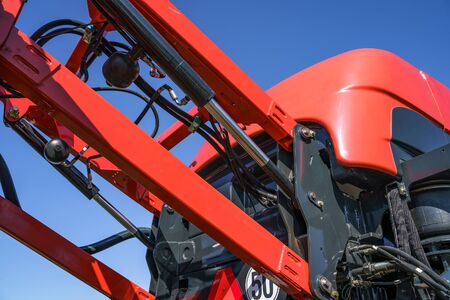 Hydraulic system, steel tubes, industrial tools equipment on agricultural machinery tractor or harvester, close up