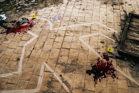 Body chalk outline, blood, markers with numbers - crime scene, Police investigation concept, toned