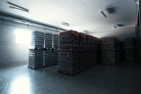 Modern warehouse interior inside, goods and cargo in half empty storage or storehouse.