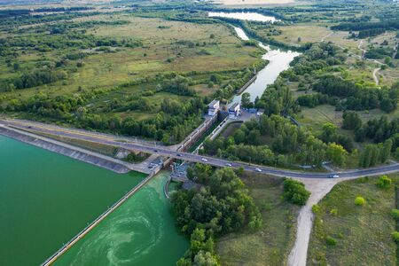Ship gateway or lock for launching ships on river, aerial view from drone. Фото со стока
