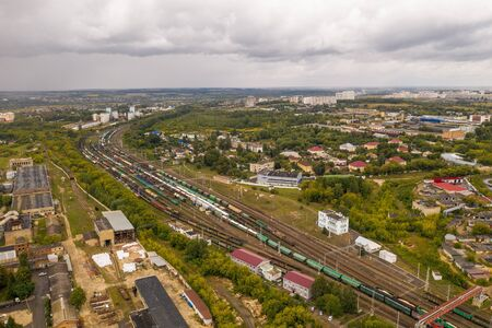 Industrial area with cargo trains on railroad, aerial view from above.