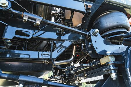 Part of agriculture machine close up with hydraulic system, steel tubes, industrial tools equipment, tractor or harvester, toned