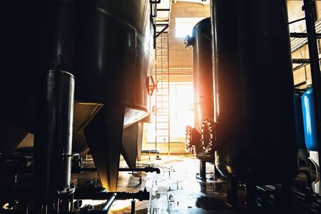 Drinking water factory or plant production, industrial interior. Large metal tanks for filtering and potable water treatment from well, toned Reklamní fotografie