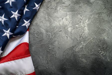 American or USA flag on concrete background with copy space for text, top view. Фото со стока