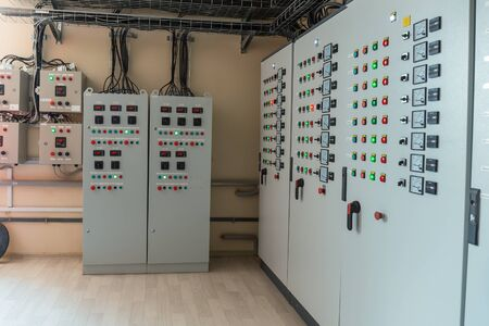 Electrical switch gear cabinets, control panels in factory. Banco de Imagens