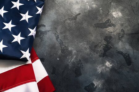 American or USA flag on concrete background with copy space for text, top view. 写真素材