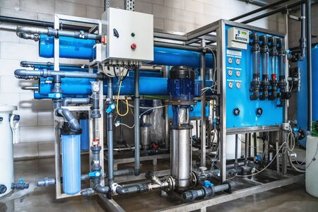 System of automatic treatment and multi-level filtration of drinking water produced from well. Plant or factory for production of purified drinking water. Reklamní fotografie