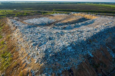 Aerial view of city dump or landfill. Pile of plastic trash, food waste and other garbage. Pollution concept. Stock Photo