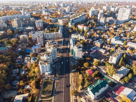 Voronezh city downtown in summer day with many buildings and roads, aerial view from drone.