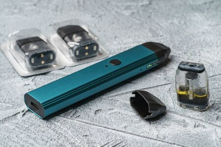 Vape pod system or pod mod with changeable cartridges close up - newest generation of vaping products - small size devices for inhaling higher nicotine strengths.