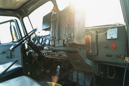 Inside interior view of military or army truck cabin, selective focus
