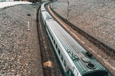 Passengers train moves fast by railroad, view from above, toned Stock Photo