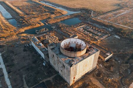 Aerial view of abandoned and ruined Nuclear Power Plant in Crimea, drone shot.