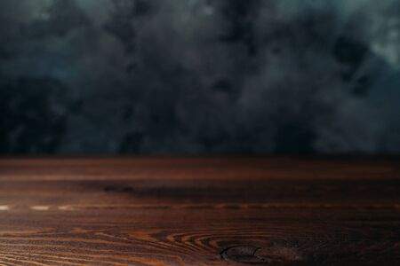 Dark wood and concrete blurred background in loft style as wallpaper or backdrop for design. Stock Photo