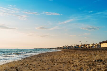 Lido di Ostia sand beach at sunset in autumn near Rome in Italy.