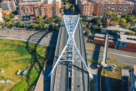 White metal bridge over railroad in one of districts of Rome, Italy, aerial view from drone. Stok Fotoğraf