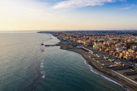 Aerial view of Ostia beach near Rome, Italy. Beautiful sea, coast and city view from above, drone photo.