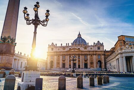 Saint Peter basilica in Vatican or Basilica Papale di San Pietro in Vaticano Rome, Italy at sunset in warm autumn evening.