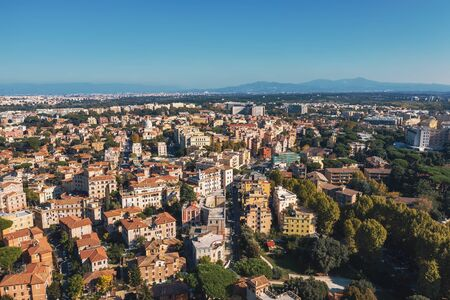 Aerial view of Rome Italy residential areas with houses, flight on drone above city buildings in sunny day.