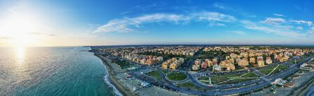 Ostia beach aerial view from drone. Ostia Lido near Rome, Italy. Beautiful sea, coast and city view at sunset from above.