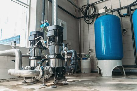 Pumps or industrial compressors for pumping water from deep well to produce purified drinking water. Stok Fotoğraf