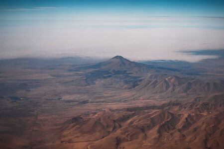 Aerial view from airplane of Turkish mountains from above.