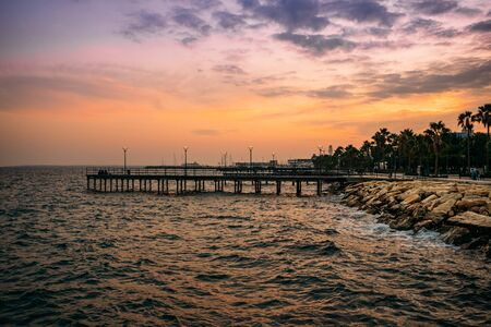 Pier at Molos Promenade park at sunset in Limassol city ,Cyprus. Beautiful evening mediterranean sea resort.