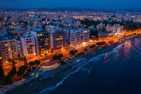 Aerial view of Limassol promenade in Cyprus at night. Drone photo of mediterranean sea resort from above. Stok Fotoğraf