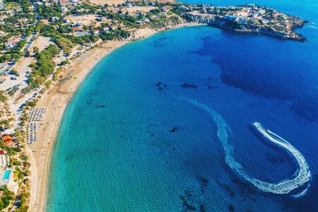 Coral Bay Beach Aerial View. Famous Cyprus beautiful coastline with azure Mediterranean sea water and sandy beach, drone shot. Stok Fotoğraf